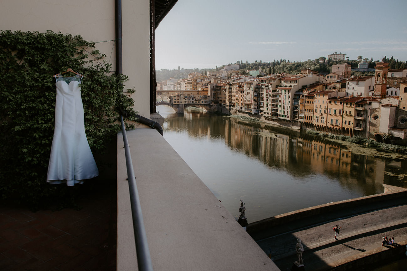 Wedding dress overlooking Ponte Vecchio in Florence Italy