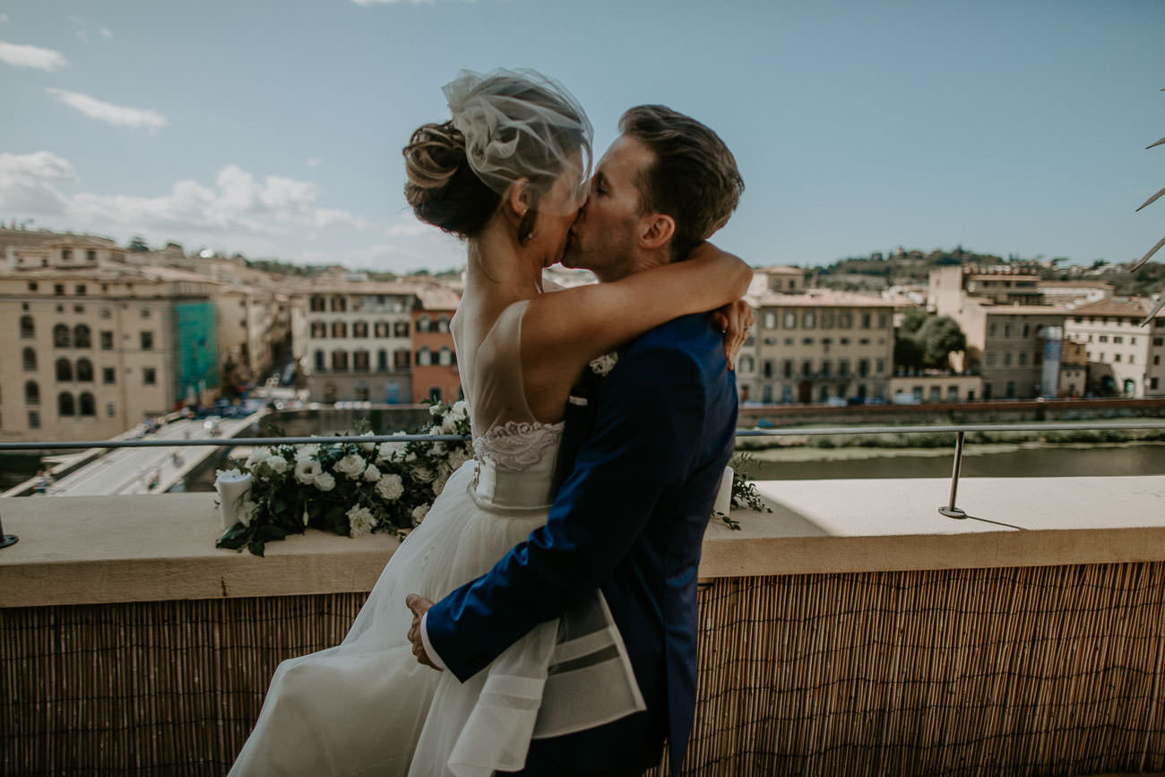 Elopement Wedding Ceremony First Kiss on hotel balcony in Florence Italy